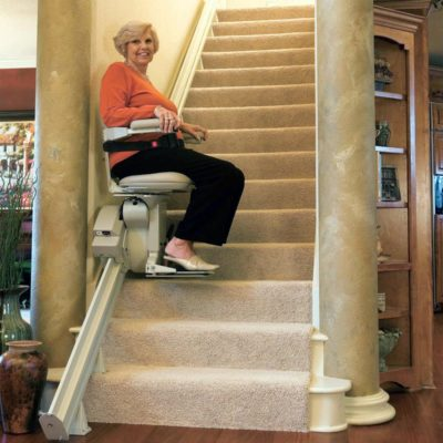 Bruno Elite Straight Stairlift Lifestyle Woman