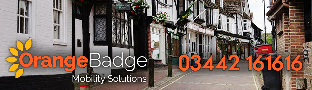 Picture of East Grinstead High Street with Orange Badge Mobility logo and 03442 161616 number