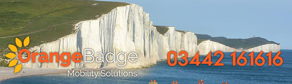 picture of the seven sisters chalk cliffs in east sussex with orange badge mobility logo and 03442 161616 number