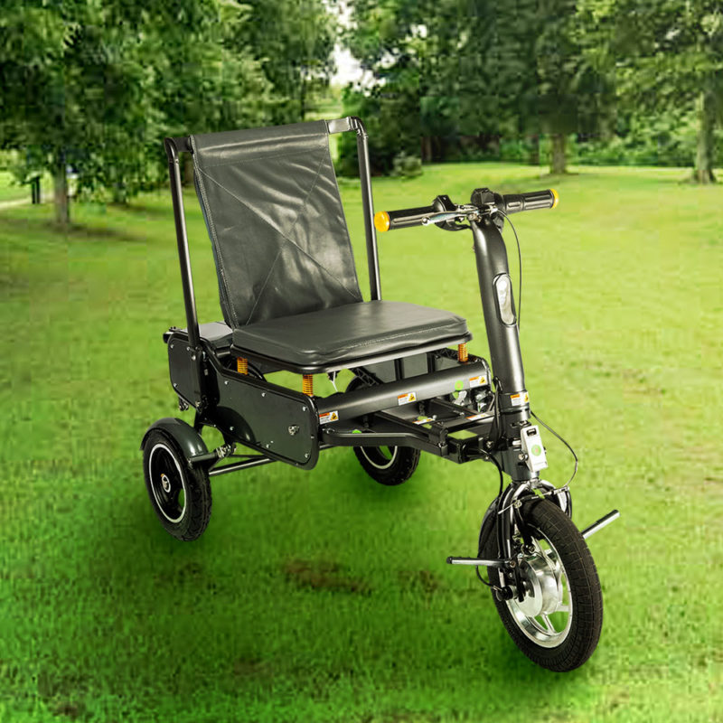 an efoldi mobility scooter sits on grass at a park in east Sussex
