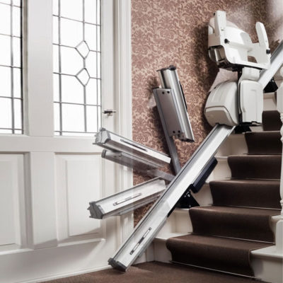 a stairlift hinge is shown in different positions with a stairlift parked above